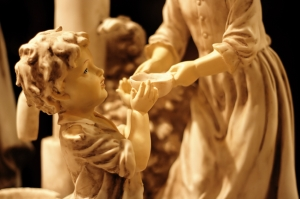 Statue of Child Receiving Gruel